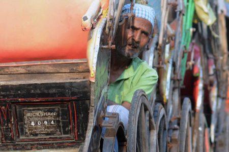 A rickshaw puller awaits passengers in Kolkata