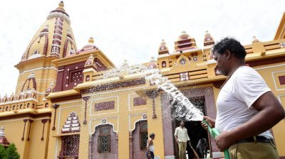 Bhopal: A temple staff washes the Birla temple as it gears up to re-open from June 8; in Bhopal on Jun 6, 2020. (Photo: IANS)