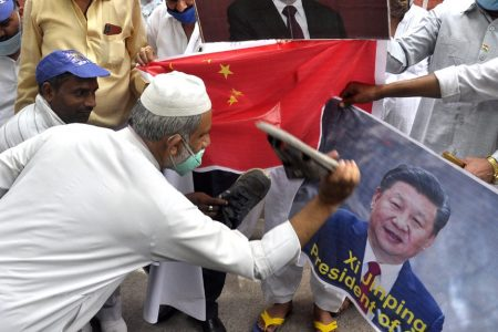 RPI workers burn the poster of Chinese President Xi Jinping