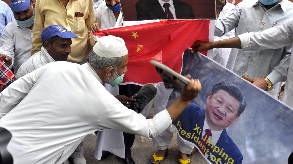 New Delhi: Rewa: Republican Party of India (RPI) workers led by party's Delhi unit president Mirza Meehtab, burn the poster of Chinese President Xi Jinping during a protest against China over the brutal attack on Indian Army personnel at Galwan valley at the Line of Actual Control that killed 20 Indian soldiers during the Indo-Chinese face off in Ladakh; in New Delhi on June 19, 2020. (Photo: IANS)