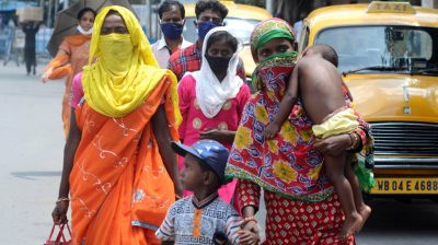 Kolkata: Migrant returnees walk past a Kolkata street after arriving in the city during the fifth phase of the nationwide lockdown imposed to mitigate the spread of coronavirus, on June 5, 2020. (Photo: Kuntal Chakrabarty/IANS)