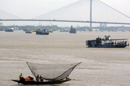 Fishermen go fishing on their boats at the Ganga river during nationwide lockdown