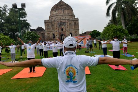 People perform yoga at the lawns of Lodhi Garden marking the 6th International Day of Yoga