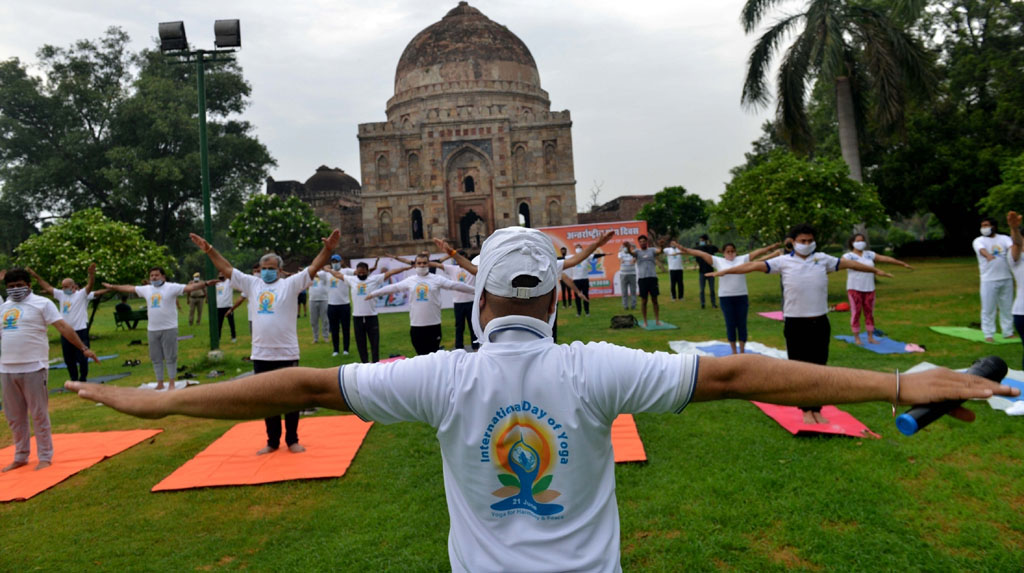 New Delhi: People perform yoga at the lawns of Lodhi Garden marking the 6th International Day of Yoga, in New Delhi on June 21, 2020. (Photo: IANS)