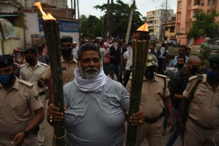 Pappu Yadav participates in a torch rally to protest against the Bihar Government