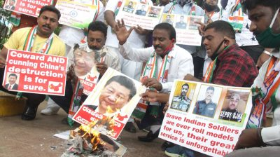 Bengaluru: Youth Congress activists burn the posters of Chinese President Xi Jinping during protest against the brutal attack on Indian Army personnel at Galwan valley at the Line of Actual Control that has killed 20 Indian soldiers during the Indo-Chinese face off in Ladakh; in Bengaluru on June 17, 2020. (Photo: IANS)