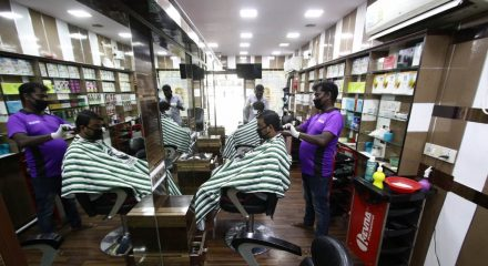 Chennai: Hairdressers busy giving hair cut to the customers after salons across Chennai reopened on the first day of the fifth phase of the nationwide lockdown imposed to mitigate the spread of coronavirus, on June 1, 2020. (Photo: IANS)