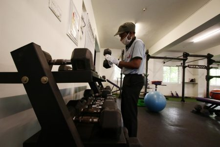 Workout equipments being sanitised at a gym as it to reopen for people