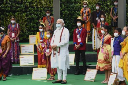 Prime Minister Narendra Modi poses for photographs with school children